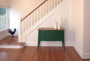 Country Staircase with Hardwood floors, Standard height, double-hung window, curved staircase