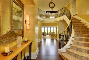 Contemporary Staircase with Crown molding, Loft, six panel door, curved staircase, Chandelier, Hardwood floors