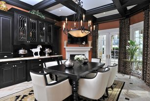 Traditional Dining Room with Standard height, complex marble tile floors, stone tile floors, Cement fireplace, Fireplace