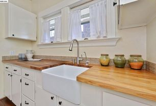 Cottage Kitchen with Vigo Single-Handle Pull-Out Sprayer Kitchen Faucet, John Boos & Co. Blended Maple Countertop, Paint