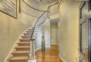 Traditional Staircase with High ceiling, Balcony, curved staircase, Chandelier, can lights, Hardwood floors