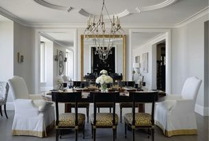 Traditional Dining Room with Laminate floors, Crown molding, Chandelier