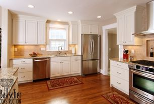 Traditional Kitchen with Kitchen island, Limestone Tile, Stone Tile, Flush, L-shaped, Simple granite counters, Raised panel