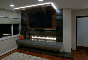 Modern Master Bedroom with Hardwood floors, Cement fireplace, Custom long gas fireplace, Cream shag area rug