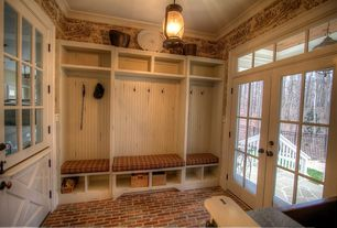 Country Mud Room with Crown molding, Brick floors, interior wallpaper, French doors, Carson Shelf Baskets - Natural