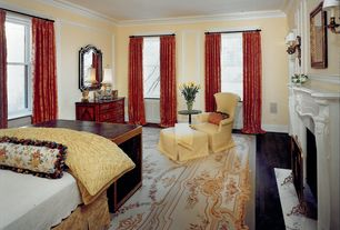 Traditional Master Bedroom with Crown molding, Wall sconce, Cement fireplace, double-hung window, Fireplace, Laminate floors
