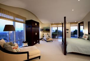 Modern Master Bedroom with picture window, Hardwood floors, Columns, Standard height, can lights