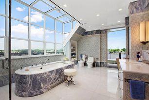 Traditional Master Bathroom with Ms international crema marfil premium marble, Limestone counters, Skylight, flush light