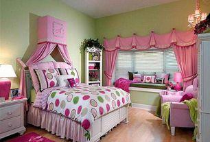 Eclectic Kids Bedroom with Hardwood floors, Bay window, Chandelier, Built-in window seat, Window seat, Built-in bookshelf