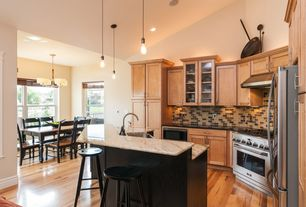 Craftsman Kitchen with Glass panel, can lights, Wall Hood, High ceiling, European Cabinets, Breakfast bar, Farmhouse sink