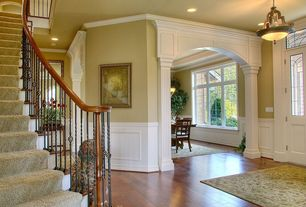 Traditional Entryway with Crown molding, Transom window, Wainscotting, French doors, Hardwood floors, Columns, can lights