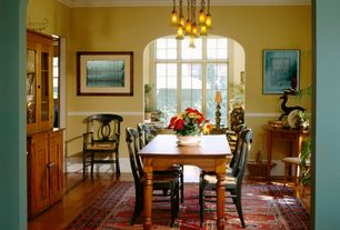 Country Dining Room with Crown molding, Standard height, Hardwood floors, Casement, Built-in bookshelf, Chair rail