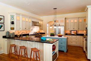 Cottage Kitchen with Pendant light, U-shaped, Soapstone counters, Kitchen island, Paint 1, Glass panel, European Cabinets