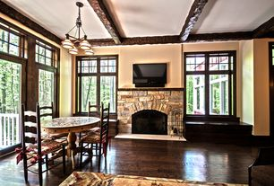 Craftsman Living Room with stone fireplace, French doors, Casement, Exposed beam, Window seat, Fireplace, Hardwood floors