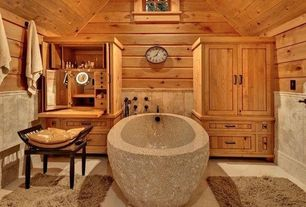 Contemporary Master Bathroom with Freestanding, Inset cabinets, Stone forest oval bath, Carved wood u shaped chair
