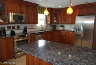 Traditional Kitchen with Kitchen island, Simple granite counters, Glass panel, Limestone Tile, Pendant light, Raised panel