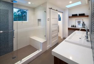 Contemporary Master Bathroom with Corian counters, European Cabinets, Pental thassos quartz, specialty door, Master bathroom