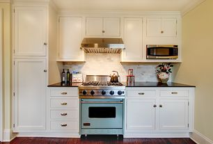 Traditional Kitchen with Limestone Tile, Soapstone counters, Inset cabinets, Flat panel cabinets, One-wall, European Cabinets