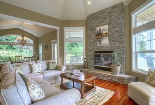 Traditional Living Room with Standard height, picture window, double-hung window, Hardwood floors, can lights, Fireplace