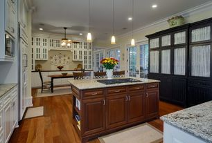 Traditional Kitchen with Simple granite counters, Breakfast nook, Crown molding, Glass panel, Kitchen island, Breakfast bar