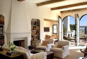 Mediterranean Living Room with Built-in bookshelf, Exposed beam, Cement fireplace, French doors, Carpet, Window seat