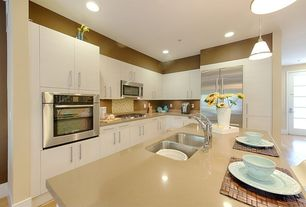 Contemporary Kitchen with European Cabinets, Pendant light, Lg hausys hi-macs-solid surface countertop in almond, Flush