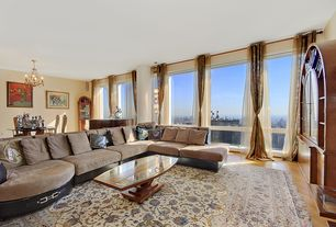 Traditional Great Room with specialty window, Hardwood floors, Built-in bookshelf, Chandelier, Standard height
