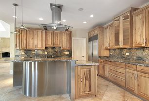 Contemporary Kitchen with Kitchen island, L-shaped, six panel door, Island Hood, Complex granite counters, Raised panel