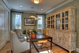 Traditional Home Office with interior wallpaper, Crown molding, Built-in bookshelf, Hardwood floors, flush light