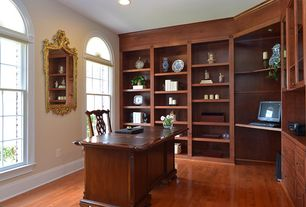 Traditional Home Office with Hardwood floors, Built-in bookshelf, Arched window, double-hung window, High ceiling, can lights
