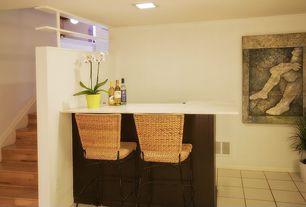 Contemporary Bar with stone tile floors, flush light, Built-in bookshelf, limestone tile floors, Standard height