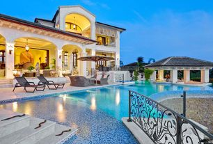 Mediterranean Swimming Pool with Deck Railing, Gazebo, exterior stone floors, specialty window, Infinity pool, Pathway