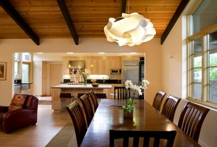 Contemporary Dining Room with Laminate floors, Chandelier, Carolina Cottage Hudson Dining Chair, Exposed beam