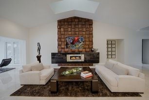 Modern Living Room with Area rug, Vaulted ceiling, Skylight, simple marble floors, Wood coffee table, Accent wall