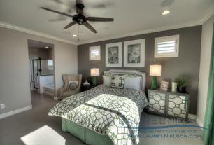 Art Deco Master Bedroom with Crown molding, Built-in bookshelf, Ceiling fan, Carpet