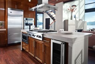 Contemporary Kitchen with Flat panel cabinets, Kitchen island, Corian counters, flush light, Pendant light, High ceiling