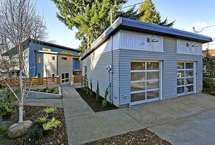 Contemporary Garage with Wall sconce, quartz floors, specialty door