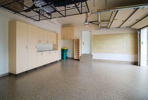 Contemporary Garage with simple granite floors, specialty door, Built-in bookshelf