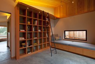 Contemporary Living Room with Built-in bookshelf, Standard height, can lights, Casement, Concrete floors, Window seat