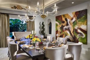 Contemporary Dining Room with Concrete floors, Chandelier