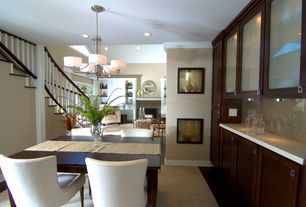 Contemporary Dining Room with Crown molding, Standard height, Built-in bookshelf, can lights, Chandelier