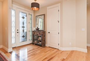 Traditional Entryway with Hardwood floors, flush light, specialty door, French doors, Standard height, Stained glass window