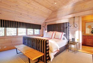 Cottage Master Bedroom with High ceiling, Casement, can lights, Hardwood floors