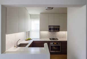 Contemporary Kitchen with Complex granite counters, U-shaped, flush light, built-in microwave, Complex Granite, Casement