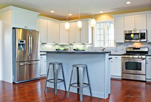 Traditional Kitchen with L-shaped, Breakfast bar, Flush, Eurostyle miller bar stool, Kitchen island, Soapstone counters