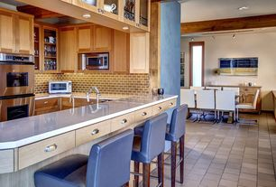 Contemporary Kitchen with Wine refrigerator, travertine tile floors, Flat panel cabinets, Exposed beam, Glass panel, U-shaped