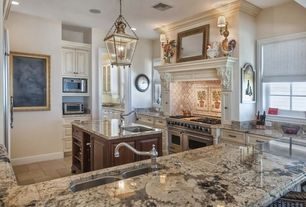 Traditional Kitchen with Wall sconce, Standard height, can lights, full backsplash, Stone Tile, Custom hood, Kitchen island