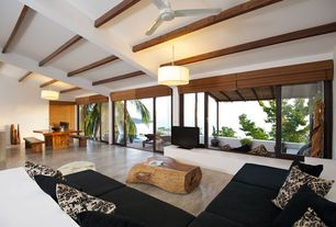 Modern Great Room with Exposed beam, flush light, French doors, Concrete floors, Cathedral ceiling, Ceiling fan
