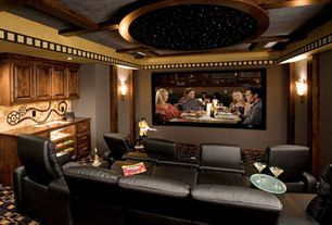 Art Deco Home Theater with Carpet, Box ceiling, Wall sconce, Built-in bookshelf