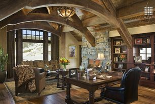 Country Home Office with Hardwood floors, flush light, Chandelier, stone fireplace, Hardwood flooring, Exposed beam